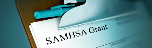 photograph of a clipboard with a SAMHSA Grant Application