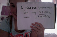 a picture of a young girl holding a sign that reads I choose prevention for my family and friends.