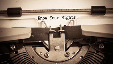 "a typewriter with ""Know your rights"" text"