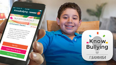 Cell phone with Knowbullying app open and a smiling boy on the background.